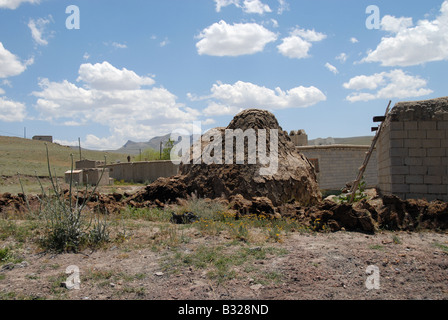 A pile of manure outside a house in Turkey - Stock Photo