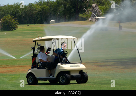 Golfers Driving Golf Buggy Varadero Cuba - Stock Photo