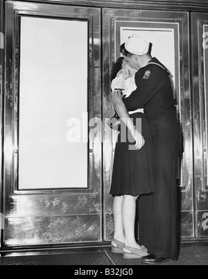 U.S. sailor & girlfriend celebrate news of end of war with Japan. Trans-Lux Theatre in New York's Time Square, August - Stock Photo