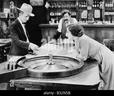 People at roulette table in bar - Stock Photo