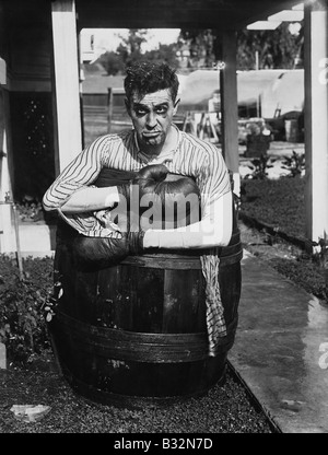 Defeated boxer in barrel outside - Stock Photo