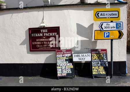 Signs on the side of a Pub in Topsham Road Directional Parking Menu - Stock Photo