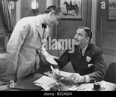 Interaction between two businessmen - Stock Photo