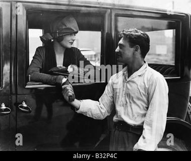 Man saying goodbye to woman in car