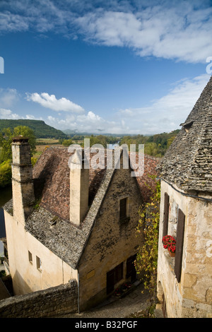 Looking out over the Beynac rooftops towards the Dordogne River and countryside, France, EU. - Stock Photo