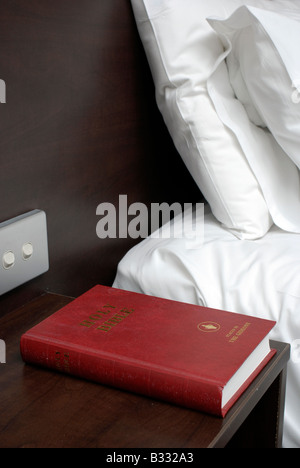 A bible left by the Gideons in a Hotel bedroom - Stock Photo