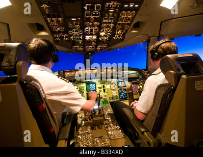 2 Pilots in Cockpit of a Boeing 757 Aircraft over Europe - Stock Photo