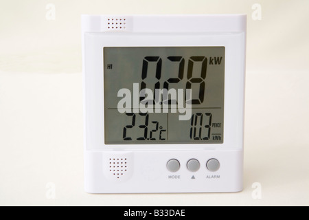 Close up Studio Wireless energy monitor showing kilowatts of electricity being used temperature and price of power - Stock Photo