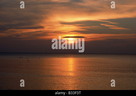 Sunrise in winter on Branksome Chine beach in Bournemouth/Poole, Dorset. - Stock Photo