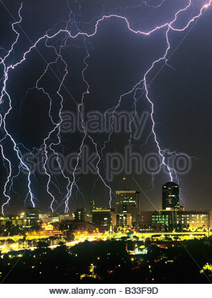 Lightning storm, thunderstorm over downtown Tucson Arizona USA with large lighting bolts in the city. - Stock Photo