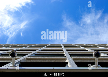 pair of cctv cameras on an office building in putney, southwest london, england - Stock Photo