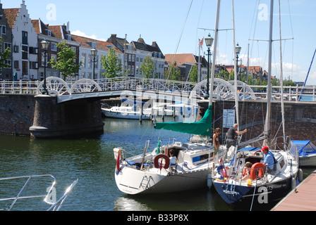 typical Dutch houses along Kinderdijk and Spijkerbrug Middelburg Zeeland Netherlands - Stock Photo
