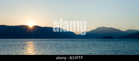 Sunrise over Marmaris Bay as seen from the jetty at Marmaris Palace Hotel - Stock Photo