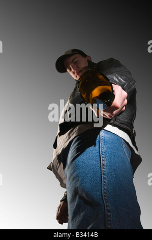Youth with broken bottle - Stock Photo