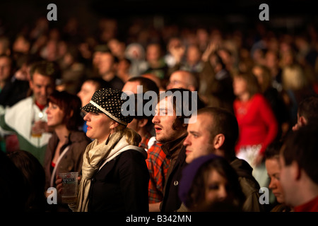 people looking bored in a crowd during a concert in Belfast - Stock Photo