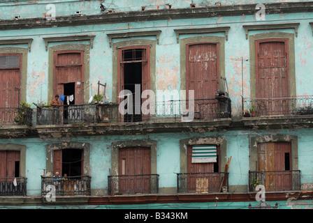 typical apartment building in Havana Cuba with balconies and derelict doorways and windows - Stock Photo
