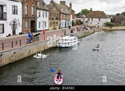 A view of the Quay from St Ives Bridge, two girls canoeing up the river Ouse - Stock Photo