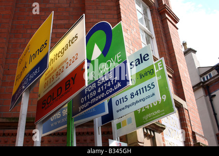 Estate agents for sale boards outside apartments in Nottingham city centre, England, U.K. - Stock Photo