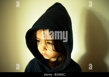 Five year old girl wears hooded robe - Stock Photo