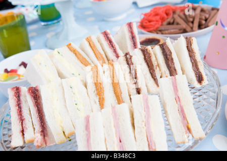 Birthday party table setting with food - Stock Photo