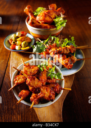 Party Food - From Front - mini chicken kebabs,Chicken Yakatori, olives, Marinated chicken drum sticks - Stock Photo