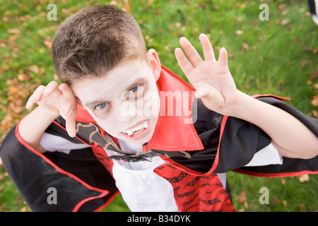 Young boy outdoors wearing vampire costume on Halloween - Stock Photo