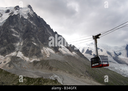 Aiguille Du Midi cable car, in bad weather, during th summer. - Stock Photo