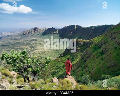Kenya, Samburu District, Losiolo. A Samburu warrior gazes at the eastern scarp of Africa's Great Rift Valley at - Stock Photo