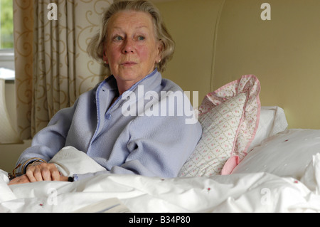 elderly lady looking confused - Stock Photo