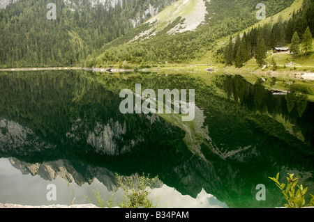 Austria Upper Austria Gosau Lake Gosau in the Dachstein Mountains the mountains reflecting in the calm clear water - Stock Photo