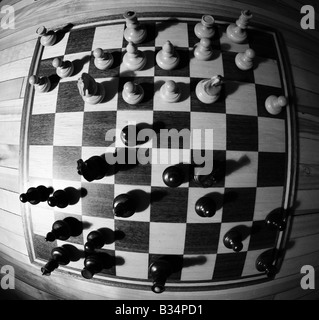 wide angle detailed images of various chess pieces, queen, king, paws, black and white on a chessboard, resign defeat, - Stock Photo