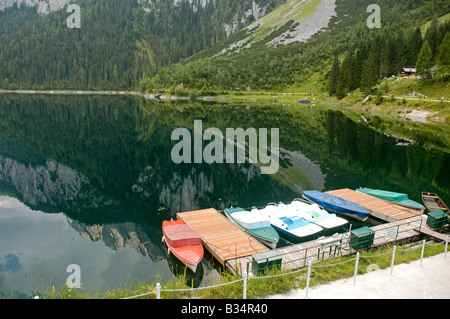 Austria Upper Austria Gosau Lake Gosau in the Dachstein Mountains boats docked to a wharf - Stock Photo