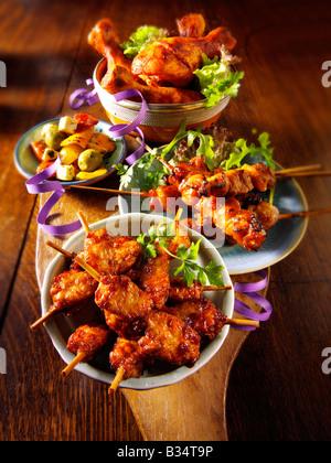Party Food - From Front - mini chicken kebabs,Chicken Yakatori, olives , Marinated chicken drum sticks - Stock Photo