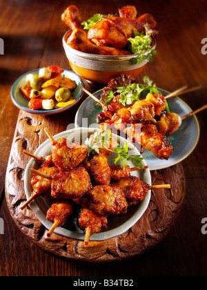 Party Food - From Front - mini chicken kebabs,Chicken Yakatori, roast peppers, Marinated chicken drum sticks - Stock Photo