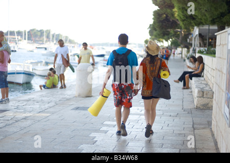 Young white couple with light camping equipment on holiday on Hvar Island Croatia - Stock Photo