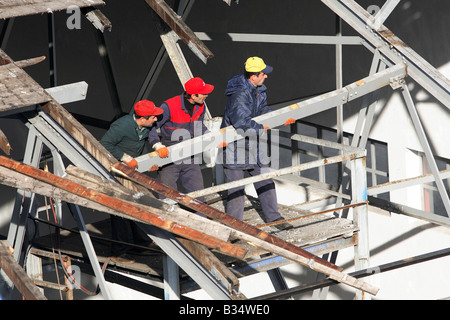 Construction workers on a scaffold, Trabzon, Turkey - Stock Photo