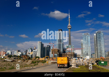 Construction dumpster truck and new condo development beside the city core of Toronto Canada with CN Tower - Stock Photo
