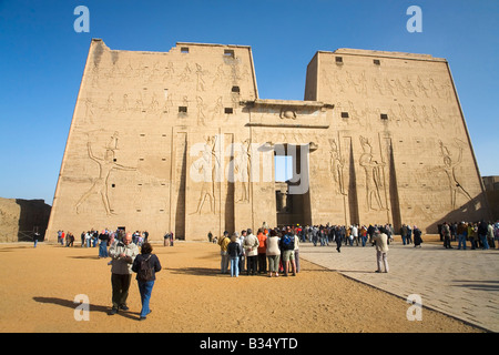 Visitors and tourists admiring the First 1st Great Pylon in Temple of Horus Edfu Egypt North Africa - Stock Photo