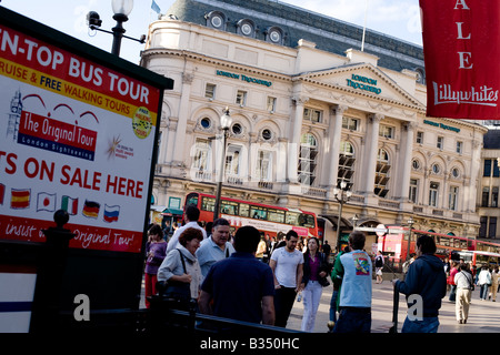 People walk around Piccadilly Circus in central London, UK - Stock Photo