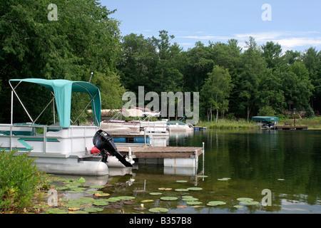 Homeowner docks on Otter Lake near Waupaca Wisconsin - Stock Photo