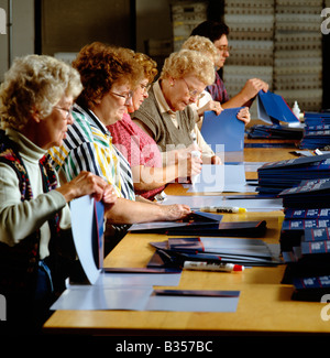 Female workers in the fulfillment department of a printing company - Stock Photo