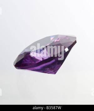 Round-cut Amethyst gemstone (lab-created) - Stock Photo