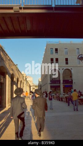 Two ultra-orthodox ('Charedi') Jews walk through the streets of the new Mamilla shoping mall in Jerusalem. - Stock Photo
