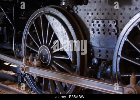 Train wheels from an old locomotive showing the solid counterbalance in each wheel. - Stock Photo
