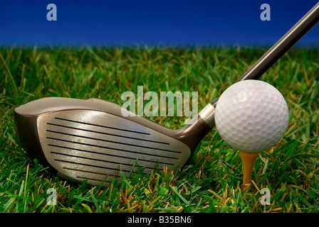 This is a close up of a golf club and a golf ball - Stock Photo