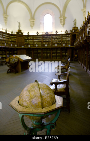 SPAIN Salamanca Globe in the Old Library rows of books line wall of La Biblioteca Antiqua in University building - Stock Photo