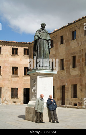 SPAIN Salamanca Two Spaniard men stand by Statue of Fray Luis de Leon outside University building oldest educational - Stock Photo