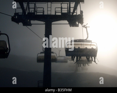 People in a chairlift in the village Warth, Austria - Stock Photo