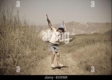 Girl on trail Santa Cruz Island Channel Islands, California, USA - Stock Photo