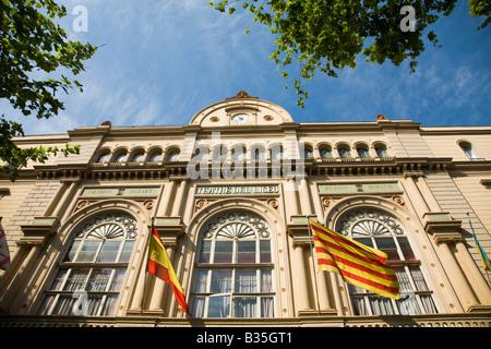 SPAIN Barcelona Exterior of Liceu Opera House along Las Ramblas flying Catalan and Spanish flags - Stock Photo